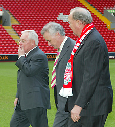 Liverpool, England - Tuesday, February 6th, 2007: American tycoons George Gillett (L) and Tom Hicks (R) on the pitch at Anfield with Chief-Executive Rick Parry after announcing their take-over of Liverpool Football Club in a deal worth around £470 million. Texan billionaire Hicks, who owns the Dallas Stars ice hockey team and the Texas Rangers baseball team, has teamed up with Montreal Canadiens owner Gillett to put together a joint £450m package to buy out shareholders, service the club's existing debt and provide funding for the planned new stadium in Stanley Park. (Pic by Dave Kendall/Propaganda)