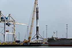 April 4, 2017 - Cape Canaveral, Florida, USA - The historic SpaceX rocket booster is hoisted off a barge Tuesday, after it arrived back home around 7:00am to Port Canaveral in Cape Canaveral, Fla. This first stage rocket booster was flown once and reused and launched from Kennedy Space Center Pad 39A March 30, 2017 at 6:27pm carrying a SES 10 satellite and returned to land on a drone barge. (Credit Image: © Red Huber/TNS via ZUMA Wire)