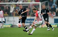 Fotball , 27. mai 2007 , AaB's Fredrik Winsnes skyder i kampen om turneringens tredjeplads i sidste runde af SAS Ligaen mellem Aab og OB på Aalborg Stadion, søndag. <br /> Norway only