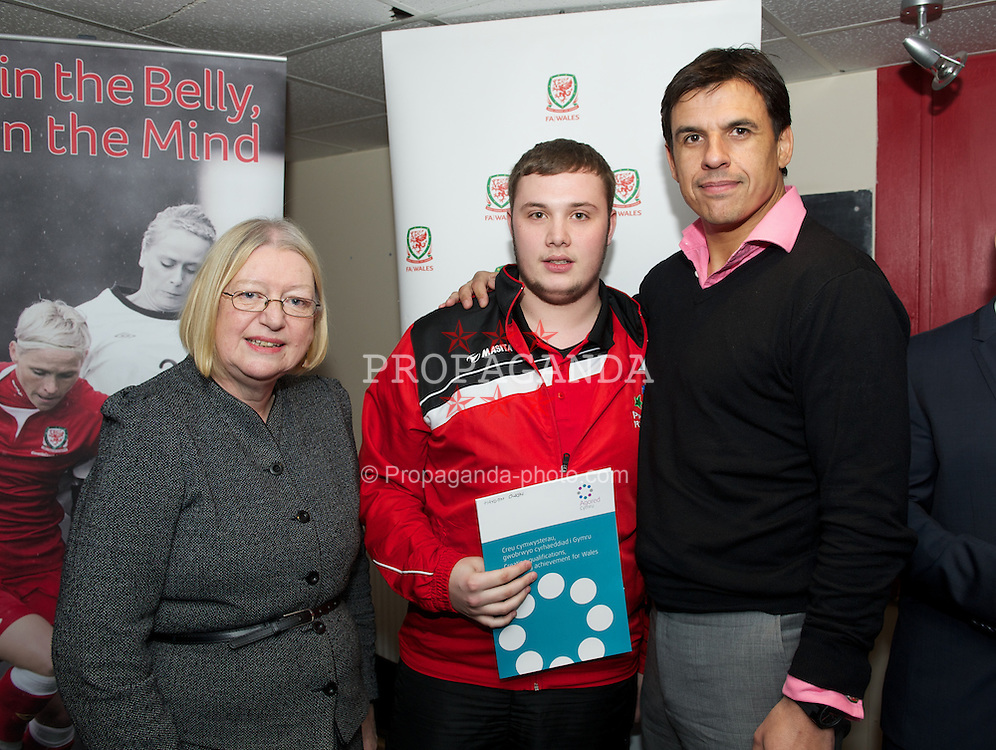 PRESTATYN, WALES - Friday, January 11, 2013: Ann Jones AM and Wales team manager Chris Coleman present a certificate to Hayden Owen during the launch of the second Project FUTSAL hub in North Wales at Prestatyn Town Football Club. (Pic by David Rawcliffe/Propaganda)