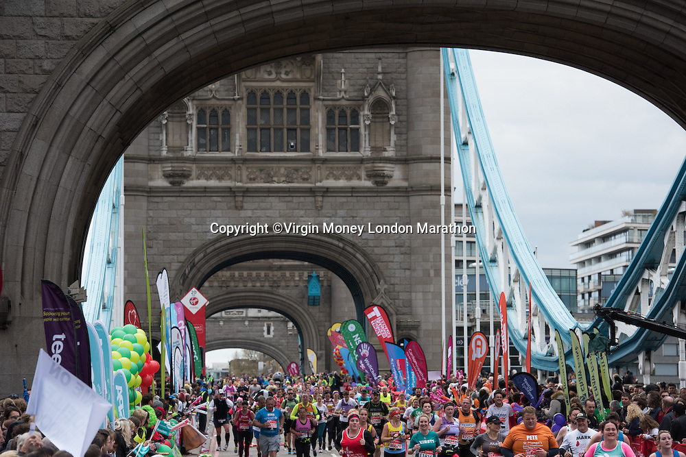 Runners cross over Tower Bridge during The Virgin Money London Marathon, Sunday 24th April 2016.<br /> <br /> Photo: Paul Gregory for Virgin Money London Marathon<br /> <br /> For more information please contact media@londonmarathonevents.co.uk