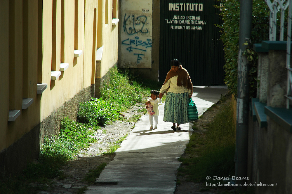 Mother and daughter walking to school in La Paz, Bolivia