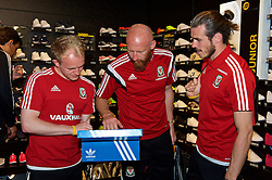 CARDIFF, WALES - Thursday, June 2, 2016: Wales' Jonathan Williams, James Collins and Gareth Bale buy Adidas trainers during a visit to a JD Sports store in Llantrisant. (Pic by Ian Cook/Propaganda)