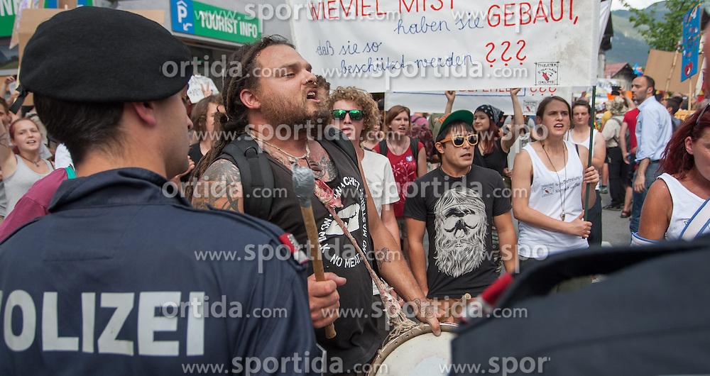 13.06.2015, Telfs, AUT, Demonstration gegen die Bilderbergkonferenz, im Bild ein Demonstrant // a demonstrant during a demonstration agiainst the bilderberg group in Telfs, Austria on 2015/06/13. EXPA Pictures © 2015, PhotoCredit: EXPA/ Jakob Gruber