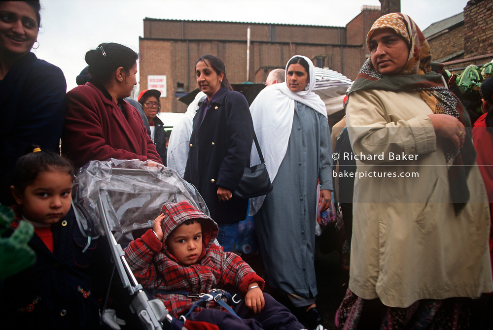 Women and their children populate the daily market in Southall, a West London neighbourhood for the British Asian community, on 16th August 1998, in London, England. (Photo by Richard Baker / In Pictures via Getty Images)