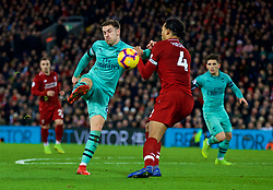 LIVERPOOL, ENGLAND - Saturday, December 29, 2018: Arsenal's Aaron Ramsey and Liverpool's Virgil van Dijk during the FA Premier League match between Liverpool FC and Arsenal FC at Anfield. (Pic by David Rawcliffe/Propaganda)