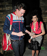 07.APRIL.2008. LONDON<br /> <br /> A DRUNK AMY WINEHOUSE LEAVING HER HOUSE AT 9.30PM WITH BLAKE. SHE ASKED THE PHOTOGRAPHERS FOR A COUPLE OF CIGARETTES TO TAKE WITH HER. SHE LATER LENT OUT OF A CAR TO GIVE A PHOTOGRAPHER &pound;20 THAT SHE HAD BORROWED FROM HIM LAST WEEK TO GET SOMETHING FROM THE SHO. SHE WENT ON TO VISIT A FRIENDS HOUSE 60 MILES OUTSIDE LONDON.<br /> <br /> BYLINE: EDBIMAGEARCHIVE.CO.UK<br /> <br /> *THIS IMAGE IS STRICTLY FOR UK NEWSPAPERS AND MAGAZINES ONLY*<br /> *FOR WORLD WIDE SALES AND WEB USE PLEASE CONTACT EDBIMAGEARCHIVE - 0208 954 5968*