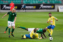 Lovro Cvek of NK Celje and Mitch Apau of NK Olimpija Ljubljana during football match between NK Olimpija Ljubljana and NK Celje in 1st leg match in Semifinal of Slovenian cup 2017/2018, on April 4, 2018 in SRC Stozice, Ljubljana, Slovenia. Photo by Urban Urbanc / Sportida