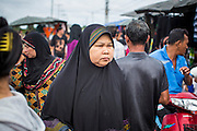 24 OCTOBER 2012 - PATTANI, PATTANI, THAILAND:  A Muslim woman in a market in Pattani, Thailand. More than 5,000 people have been killed and over 9,000 hurt in more than 11,000 incidents, or about 3.5 a day, in Thailand's three southernmost provinces and four districts of Songkhla since the insurgent violence erupted in January 2004, according to Deep South Watch, an independent research organization that monitors violence in Thailand's deep south region that borders Malaysia. Muslim extremists are battling the Thai government and its symbols, like schools and Buddhist facilities.    PHOTO BY JACK KURTZ