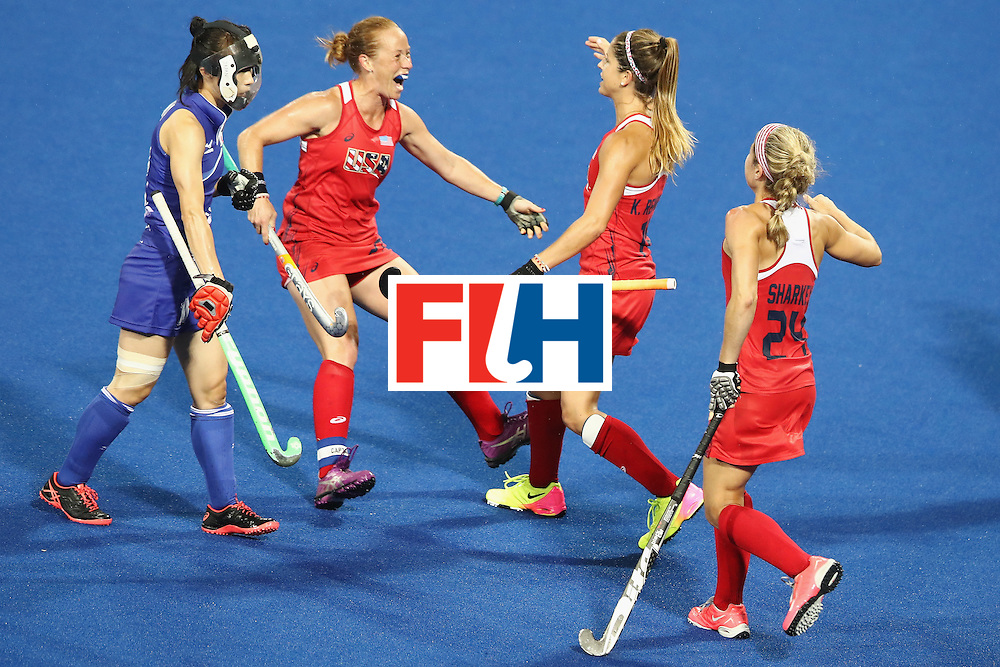 RIO DE JANEIRO, BRAZIL - AUGUST 10:  Paige Selenski of the United States celebrates with Katie Reinprecht and Kathleen Sharkey of the United States after Reinprecht scored a goal during the women's pool B match between the United States and Japan on Day 5 of the Rio 2016 Olympic Games at the Olympic Hockey Centre on August 10, 2016 in Rio de Janeiro, Brazil.  (Photo by Mark Kolbe/Getty Images)