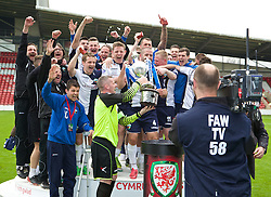 WREXHAM, WALES - Saturday, May 3, 2014: The New Saints' goalkeeper Paul Harrison lifts the Welsh Cup trophy after beating Aberystwyth Town 3-2 during the Welsh Cup Final at the Racecourse Ground. (Pic by David Rawcliffe/Propaganda)