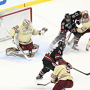 Mike Szmatula #19 of the Northeastern Huskies controls the puck in front of Thatcher Demko #30 of the Boston College Eagles, Scott Savage #28 of the Boston College Eagles, and Torin Snyderman #17 of the Northeastern Huskies during The Beanpot Championship Game at TD Garden on February 10, 2014 in Boston, Massachusetts. (Photo by Elan Kawesch)