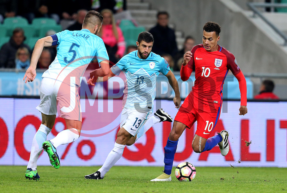 Dele Alli of England takes on Bosrjan Cesar and Bojan Jokic of Slovenia - Mandatory by-line: Robbie Stephenson/JMP - 11/10/2016 - FOOTBALL - RSC Stozice - Ljubljana, England - Slovenia v England - World Cup European Qualifier