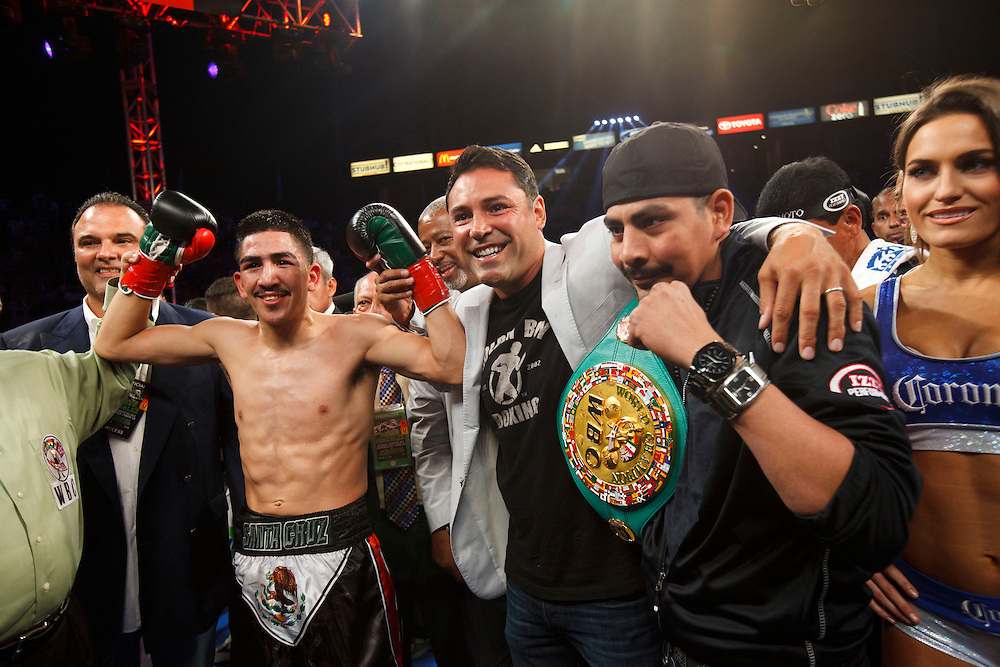 Oscar De La Hoya, as promoter of the fight, poses for a picture with Leo Santa Cruz after he knocked out Victor Terrazas for the WBC Super Bantamweight Title Fight at the StubHub Center on Saturday, August 24, 2013 in Carson, California. Patrick T. Fallon/For The New York Times