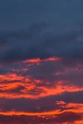 Bright orange clouds over Reykjavik at sunset.