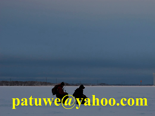 Scandinavia Finland ice fishing on frozen ice lake