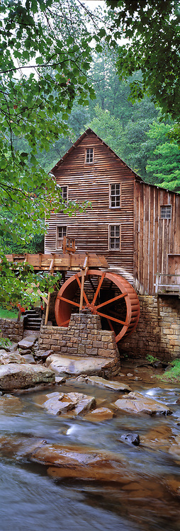 The vertical format enhances the aging structures of Glade Creek Grist Mill, in West Virginia's Babcock State Park