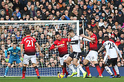 Fulham striker Aleksandar Mitrovic (9) battles with Manchester United Defender Chris Smalling and Manchester United Midfielder Nemanja Matic during the Premier League match between Fulham and Manchester United at Craven Cottage, London, England on 9 February 2019.