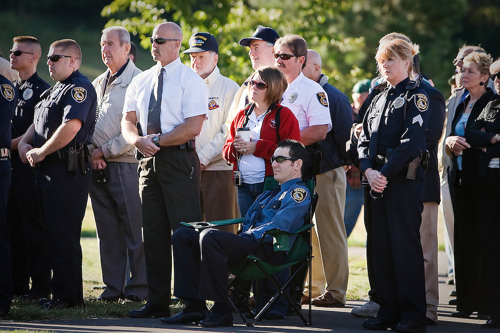 JEROME A. POLLOS/Press ..Michael Kralicek sits among his fellow Coeur d'Alene Police officers during the Sept. 11 ceremony at the Fallen Heroes Plaza in Coeur d'Alene. Kralicek was shot in the face in late 2004 while assisting in the arrest a drunk-driving suspect.