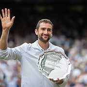 LONDON, ENGLAND - JULY 16:  Marin Cilic of Croatia salutes the crowd with his runners-up trophy after the Gentlemen's Singles final of the Wimbledon Lawn Tennis Championships at the All England Lawn Tennis and Croquet Club at Wimbledon on July 16, 2017 in London, England. (Photo by Tim Clayton/Corbis via Getty Images)