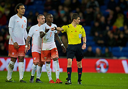 CARDIFF, WALES - Friday, November 13, 2015: The Netherlands' Quincy Promes complains to referee Benoit Bastien after a penalty is awarded to Wales during the International Friendly match at the Cardiff City Stadium. (Pic by David Rawcliffe/Propaganda)