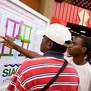 Visitors look at a map at the 22nd Salon International de l'Artisanat de Ouagadougou (SIAO) in Ouagadougou, Burkina Faso on Saturday November 1, 2008.