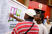 Visitors look at a map at the 22nd Salon International de l'Artisanat de Ouagadougou (SIAO) in Ouagadougou, Burkina Faso on Saturday November 1, 2008.
