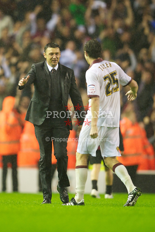 LIVERPOOL, ENGLAND - Wednesday, September 22, 2010: Northampton Town's manager Ian Sampson and Ben Tozer celebrate a famous victory over Liverpool after a penalty shoot-out during the Football League Cup 3rd Round match at Anfield. (Photo by David Rawcliffe/Propaganda)
