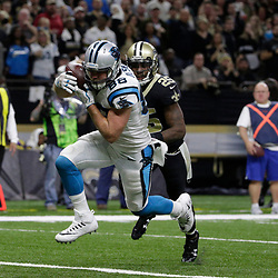 Jan 7, 2018; New Orleans, LA, USA; Carolina Panthers tight end Greg Olsen (88) catches a pass for a touchdown  against New Orleans Saints defensive back Rafael Bush (25) during the fourth quarter in the NFC Wild Card playoff football game at Mercedes-Benz Superdome. Mandatory Credit: Derick E. Hingle-USA TODAY Sports