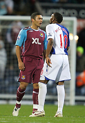 BLACKBURN, ENGLAND - Sunday, December 9, 2007: Blackburn Rovers' Benni McCarthy clashes with West Ham United's Hayden Mullins during the Premiership match at Ewood Park. (Photo by David Rawcliffe/Propaganda)