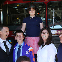 (Boston, MA - 4/15/15) Martin Richard's father, Bill, brother, Henry,  sister, Jane, and mother, Denise, and Firefighter Joe Montoya of Engine, right, pose for a photo at the Back Bay Fire Station, Wednesday, April 15, 2015. Staff photo by Angela Rowlings.