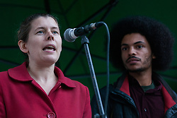 London, UK. 1st December, 2018. Claire James of the Campaign against Climate Change addresses the Together for Climate Justice demonstration against Government policies in relation to climate change, including Heathrow expansion and fracking. Following a rally outside the Polish embassy, chosen to highlight the UN's Katowice Climate Change Conference which begins tomorrow, protesters marched to Downing Street.