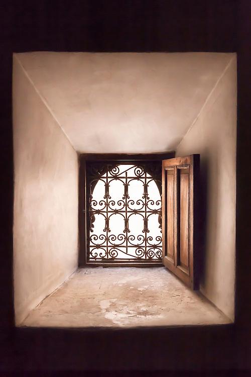 Window with steel grid in the Medersa Ben Youssef, Marrakech.