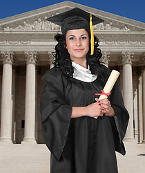 Young woman in cap and gown holding a diploma on a white background