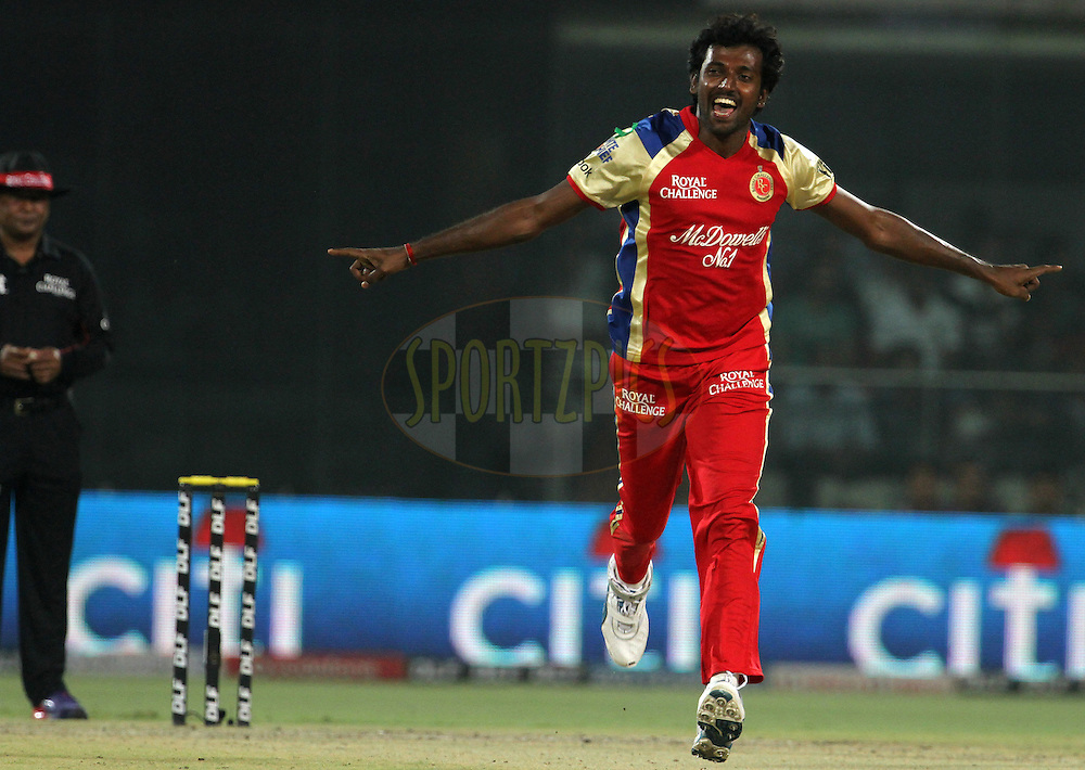 Royal Challengers Bangalore player Prasanth Parameswaran celebrates after taking a wicket during match 67 of the Indian Premier League ( IPL) 2012  between The Delhi Daredevils and the Royal Challengers Bangalore held at the Feroz Shah Kotla, Delhi on the 17th May 2012..Photo by Vipin Pawar/IPL/SPORTZPICS