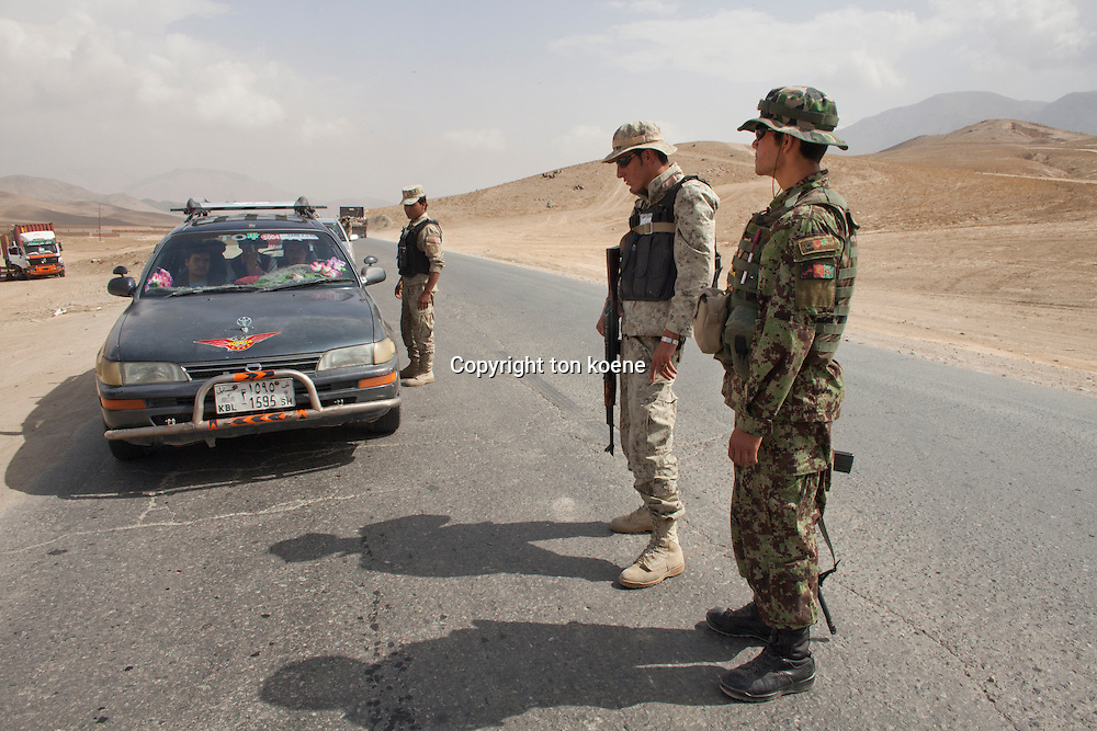Afghan police and military checkpoint looking for suspected terrorists