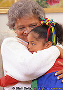 Grandmother hugs grandchild at home