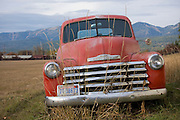 Montana,Whitefish. A vintage red Chevy truck in a field. PLEASE CONTACT US FOR DIGITAL DOWNLOAD AND PRICING.