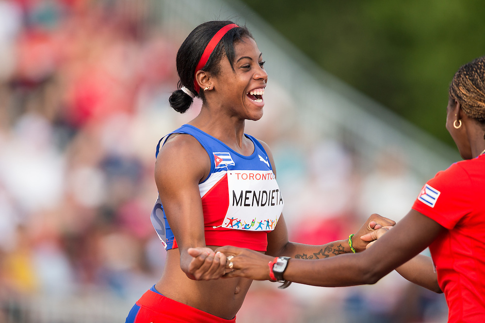 Yusleidys Mendieta of Cuba celebrates after throwing 14.40 metres in the shot put during the women's heptathlon competition at the 2015 Pan American Games at CIBC Athletics Stadium in Toronto, Canada, July 24,  2015.  AFP PHOTO/GEOFF ROBINS