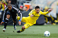 March 16, 2013; Columbus, OH, USA; San Jose Earthquakes defender/midfielder Justin Morrow (15) and Columbus Crew forward Jairo Arrieta (25) go for the ball in the first half at Crew Stadium. Mandatory Credit: Rick Osentoski-USA TODAY Sports