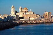 SPAIN, ANDALUSIA CADIZ;  the Cathedral and city skyline above the harbor on the Atlantic