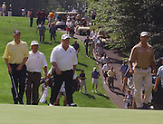 Jun 26, 2006; Gaylord MI; (left to right) Andy North, Fred Couples, Craig Stadler and Chris DiMarco walk up the the first green during the secong round of the ING Par-3 Shootout at Treetops Resort in Gaylord Michigan.