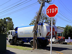 Auckland-Refuse truck clashes with power pole, Epsom