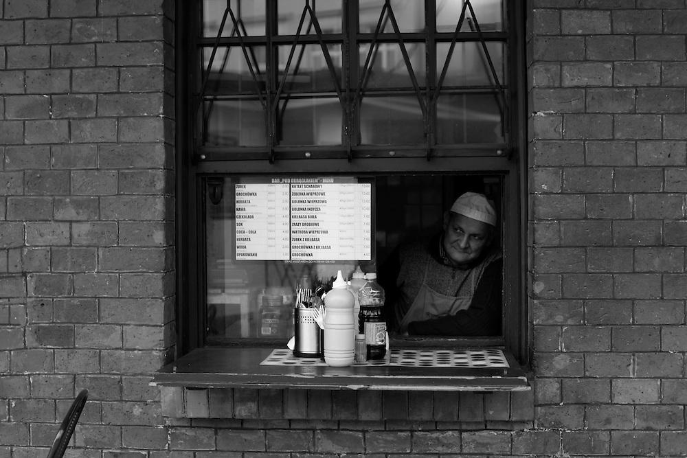 Man in window, Krakow