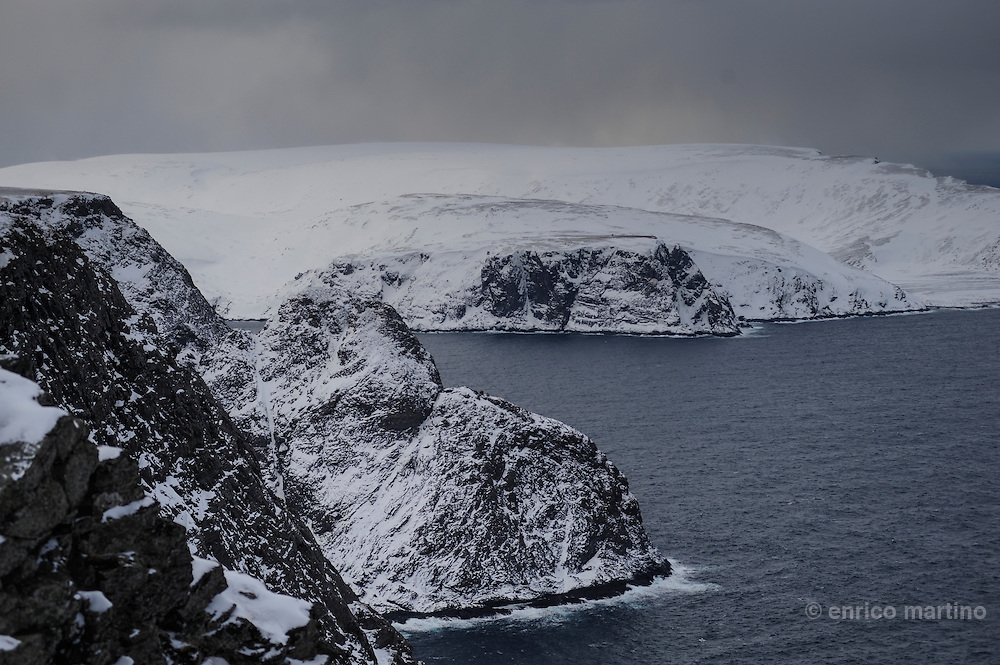 North Cape is a cape on the island of Magerøya in northern Norway, in the municipality of Nordkapp. Its 307 m high, steep cliff is often referred to as the northernmost point of Europe, located at 71°10′21″N, 2102.3 km from the North Pole. However, the neighbouring point Knivskjellodden is actually 1,457 metres further north.