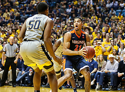 Dec 5, 2017; Morgantown, WV, USA; Virginia Cavaliers forward Isaiah Wilkins (21) drives to the basket while guarded by West Virginia Mountaineers forward Sagaba Konate (50) during the first half at WVU Coliseum. Mandatory Credit: Ben Queen-USA TODAY Sports