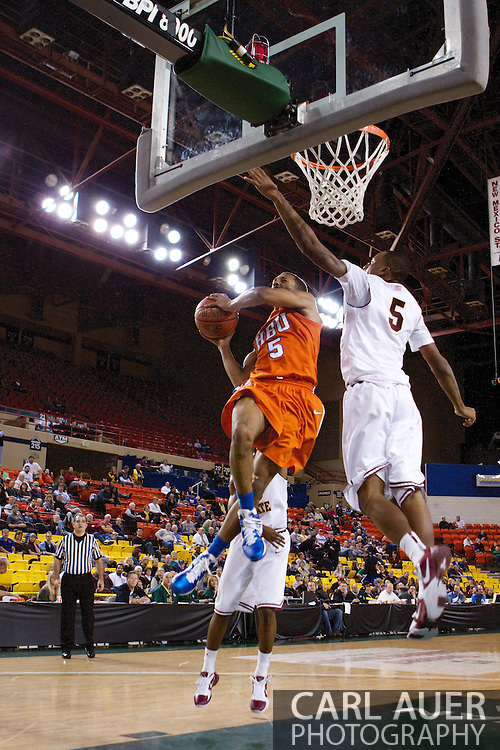 November 25th, 2010:  Anchorage, Alaska - Houston Baptist guard, Miles Dixon (5) attempts a shot in the Huskies 55-73 loss to Arizona State in a first round game of the Great Alaska Shootout.