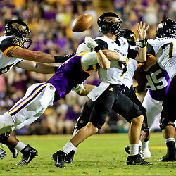 Oct 15, 2016; Baton Rouge, LA, USA;  LSU Tigers defensive end Tashawn Bower (46) forces a fumble by Southern Miss Golden Eagles quarterback Nick Mullens (9) during the second quarter of a game at Tiger Stadium. Mandatory Credit: Derick E. Hingle-USA TODAY Sports