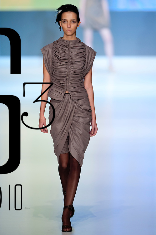 HONG KONG - JANUARY 21:  A model displays a creation of Yam Chan on the catwalk during the HK Fashion Designers Association show as part of the  Hong Kong Fashion Week Fall/Winter 2010 on January 21, 2010 in Hong Kong.  Photo by Victor Fraile / studioEAST