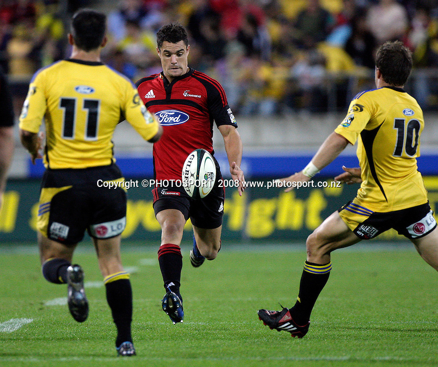 Dan Carter chips the ball through during the 2008 Super 14 Rugby Union match between the Crusaders and the Hurricanes at Westpac Stadium, Wellington, on Friday 28 March 2008. Photo: Anthony Phelps/PHOTOSPORT